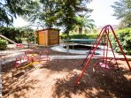 Our playground has a trampoline, swings, slide, mud kitchen and gymnastic bars.