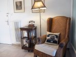 The entry lounge with wicker armchair