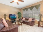 Family Room, with comfy sofas and Media Center