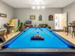 Great Games Room, with pool, air hockey, sofas and TV.