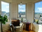 The south facing turret windows in the living room are an excellent place to sit, read, and relax