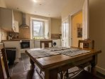 Kitchen with extendable dining table, sits up to 8 people.