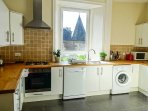 Fully equipped kitchen with wooden worktops.