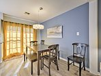 Wine and dine at the wooden dining table by the kitchen.