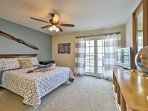 The master bedroom has a queen bed and access to a private balcony.