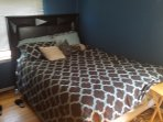1 upstairs bedroom features double bed and O.T.A. (over-the-air) HDTV