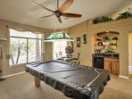 Mix a cocktail at the wet bar and enjoy a friendly match of pool.