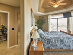 The center master suite boasts a flat-screen TV and pristine en suite bathroom.