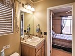 A Jack-and-Jill bathroom separates 2 of the home's guest bedrooms.
