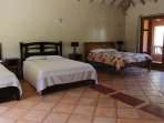 Three queen beds and one twin bed in this bedroom