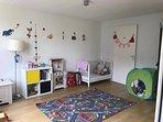 Toddler (1st) bedroom adjacent to living room