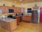 Kitchen with stainless steel appliances and granite counter.