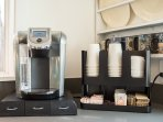Kuerig Coffee maker with complimentary coffee, teas and cocoa
