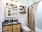 Shower w/ soap, shampoo and conditioner provided. Enjoy large stand up shower w/great water pressure