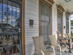 Unwind on the spacious front porch of this historic home.