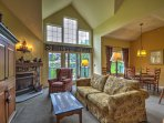 Relax in front of the cathedral ceilings, mountain-themed decor, and floor-to-ceiling windows where natural light pours...