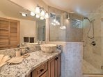 Freshen up in this elegant bathroom after a day of adventures.