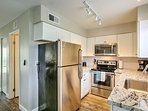 The kitchen features stainless steel appliances, upgraded counter tops and a tile backslash.