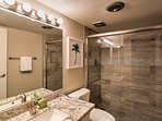 The pristine full bathroom features a luxurious shower.