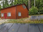 The new home is situated on 12.5 acres of secluded woodlands full of redwood trees.