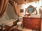The full bathroom upstairs has an oversized antique clawfoot tub, as well as an antique vanity.