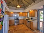 Prepare delicious recipes in the fully equipped kitchen.