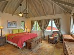 Head upstairs to the master bedroom, which features a king-sized bed.
