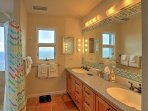The master bathroom has a large vanity with 2 sinks.