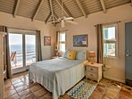 The second bedroom is located in a guest house and has a queen-sized bed, as well as access to a private balcony.