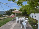 Dine under the Vines or relax in the Hammock