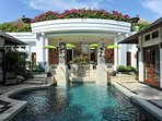 Villa swimming pool surrounded by Balinese courtyard