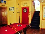 Downstairs has beer fridge, Premium Sports Channels, pool table darts, and wet bar.