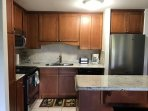Newly updated kitchen cabinets, counter tops, and appliances.