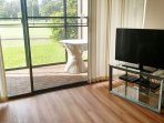 Living Room. New flat screen TV. Screened in lanai overlooking the Fazio Golf Course.