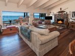 Wood burning fireplace, couch seating for six, and cute Tahoe decorations