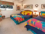 Third guest bedroom with two double beds
