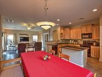 With 1,700 square feet of living space, you and your guests will love taking advantage of this home's open-concept...