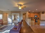 The home's spacious open-layout allows you to talk with your guests who are lounging in the living room while you're...