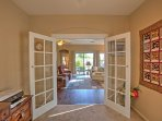 The wide glass doors add to the open layout of this bright home.