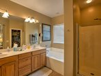 The beautiful master bath boasts Jack-and-Jill sinks, a walk-in shower, and large bath tub.