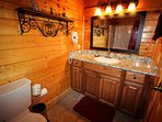 DOWNSTAIRS FULL BATH WITH BLOW DRYER PROVIDED. OAK CABINET & GRANITE COUNTER TOP