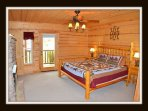 1 of 5 bedrooms - master bedroom - king bed - door to front porch - gas fireplace - main level