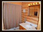 2 of 5 full bathrooms - attached to 2nd bedroom - main level