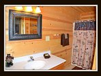 3 of 5 bathrooms - attached to 3rd bedroom - main level