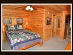 5 out of 5 bedrooms - queen bed - door to attached bathroom - hallway to stairs & another bedroom - upper level