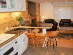 TV for living room, eat-in kitchen peninsula. High chair attaches to bar stool.