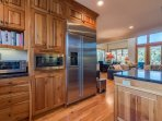 The kitchen is conveniently located on the same level as the living space, so you won't miss out on views while you...