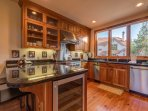 The kitchen features a breakfast bar with seating for 2.