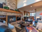 This living room offers comfortable seating for all group members as well as exquisite stonework.