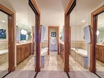 The ensuite for bedroom 3 has dual closets as well as sinks.